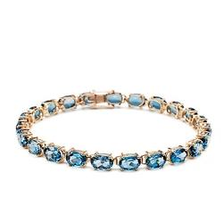 Staviori bransoleta 19cm. 23 topazy błękitne, masa 20 ct.. żółte złoto 0,585.   london blue topaz