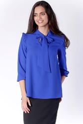 Kobieca kobaltowa bluzka z dekoracyjnym wiązaniem i falbanką