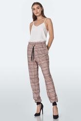 Wzorzyste spodnie z wiązaniem w pasie - beżowe