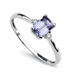 Staviori pierścionek. 2 diamenty, szlif brylantowy, masa 0,06 ct., barwa h, czystość i1. 1 tanzanit, masa 0,60 ct.. białe złoto 0,585. średnica korony ok. 4x6 mm. szerokość obrączki ok. 2 mm.