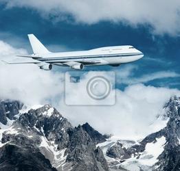 Fototapeta samolot lecący nad górami ośnieżone.