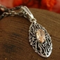 Onda - srebrny wisiorek z topazem złocistym