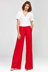Czerwone stylowe spodnie damskie z szerokimi nogawkami