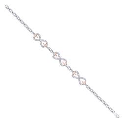 Staviori Bransoleta 18cm. 63 Diamenty, szlif brylantowy, masa 0,25 ct., barwa H, czystość SI2. Białe, Różowe Złoto 0,585. Wymiary 9x23 mm. Szerokość 3,9 mm.