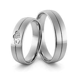 Obrączki ślubne z białego złota niklowego splecione serca  z brylantami - au-969