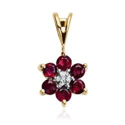 Staviori wisiorek. 1 diament, szlif brylantowy, masa 0,005 ct., barwa h, czystość i1. 6 rubinów, masa 0,40 ct.. żółte złoto 0,585. średnica 8 mm. długość 14 mm.